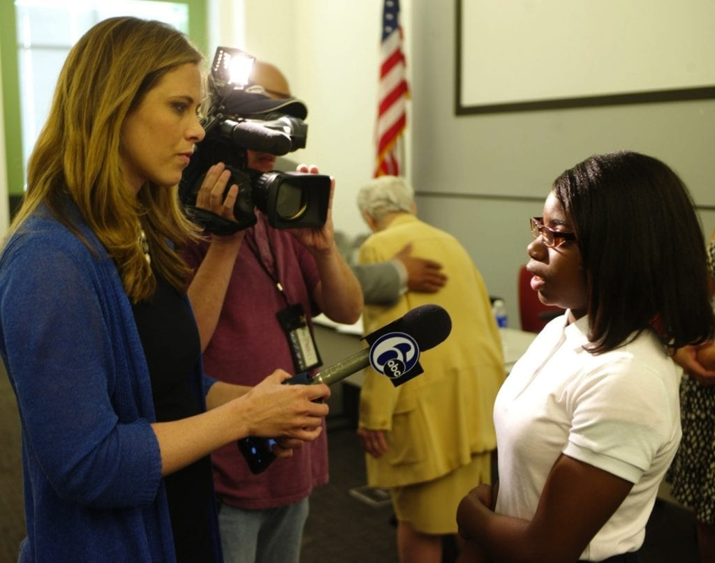 Young school girl is interviewed by the media at a recent Mayoral Candidate Forum