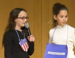 young female students answer judge's questions