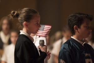 young girl answers judges panel questions at Citizenship Challenge