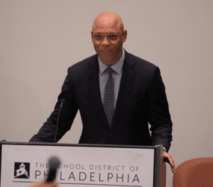 Philadelphia School Superintendent Hite stands at the forum podium