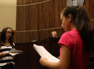 students engage in a mock trial with Judge Marjorie Rendell